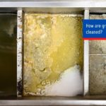 How are grease traps cleaned?